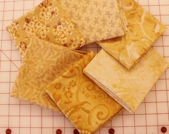 Bundle of 6 Hefty Fat Quarters in shades of Gold through Cream