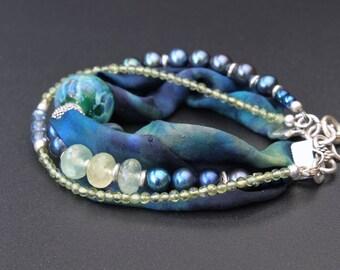 Lampwork, silk, silver and pearls multi strand bracelet