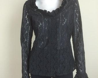 black lace blouse w/ dramatic ruffled collar & cuffs