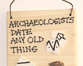 Archaeologists Date Any Old Thing wooden sign archaeology history arrowhead potsherds plaque