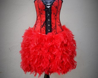Red corset dress with feather skirt and sequin trim