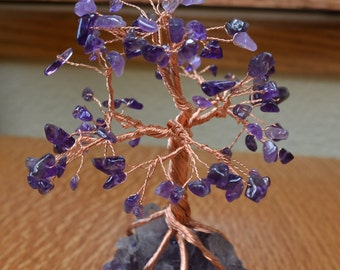 Amethyst and copper or silver tree sculpture on a amethyst geode rock