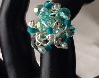 BR1720 Bling ring, aqua and turquois crystals, wrapped in silver wire, size 7