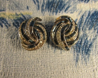 circa 1960s blue baguette stone twist clip-on earrings