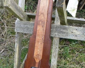 Left handed lap steel guitar hand made from reclaimed hardwood