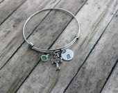 Celtic cross charm bracelet, stainless steel adjustable bangle, with celtic cross Swarovski crystal birthstone and hand stamped initial disc