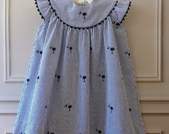Girl's Round Yoke Dress featuring Embroidered Palmetto with Crescent Moon on Seersucker