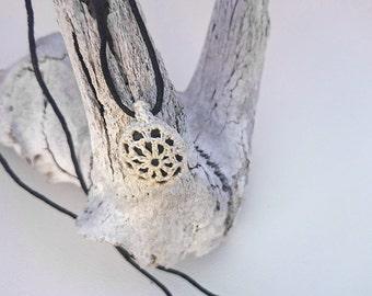 Black river stone crochet lace pendant, Crochet covered pebble necklace - Adjustable necklace