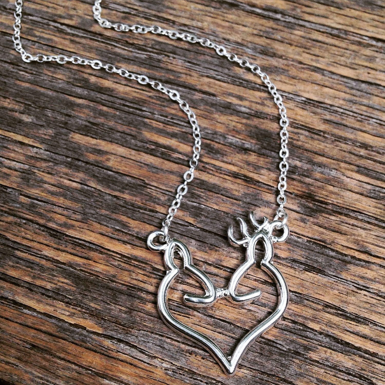 buck and doe shaped necklace smaller charm