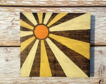 Yellow and Orange sun sign hand painted on reclaimed wood