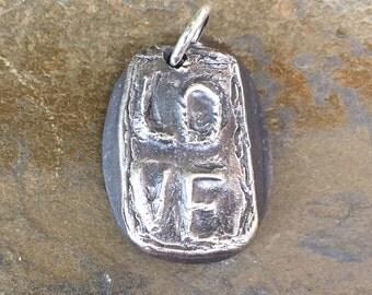 Organic, fine silver LOVE pendant or charm.