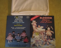 2 realistic baby doll books and 1 1/3 yards skin fabric,Blossom Children and Friends,26 projects,and Foster Children Wee Tots ,patterns
