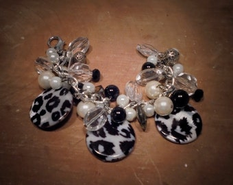 black / white shell and mother of pearl charm bracelet.