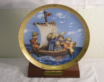 "M.J. Hummel ""Land in sight"" plate with display stand"