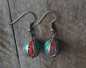 Beautiful earrings with Nepalese beads, inlaid with red and turquoise rhinestones