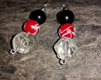 Red glassbead with clear and black accent