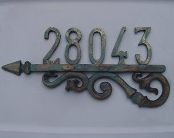Left House numbers Arrow pointing to left of house numbers with plate up to 5 numbers 0603
