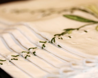 Set of six hand embroidered white napkins
