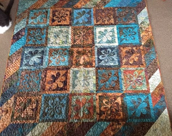 Machine appliqued quilt in gorgeous bali fabrics
