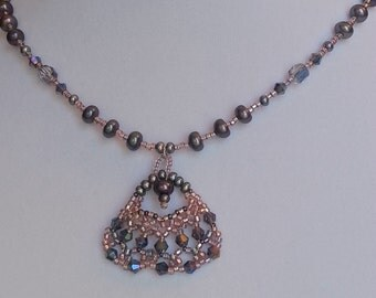 Handmade necklace made of pearls, crystals and pink seed beads.