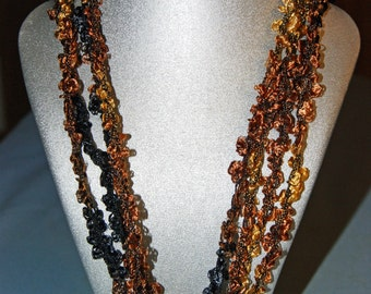 Beautiful, vibrant fall colored, lightweight  crocheted necklace.  Adjustable length