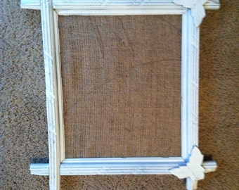 White Antique wood frame with leaves in two corners