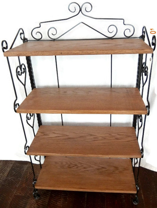handcrafted wrought iron bookcase shelves with delicate. Black Bedroom Furniture Sets. Home Design Ideas