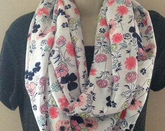 A beautiful very lightweight floral infinity scarf.  This is the perfect spring scarf.