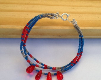 Bracelet adorned with rockeries beads and drops.