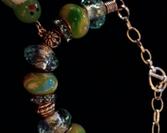 Large hole deaded bracelet with penguin charm.