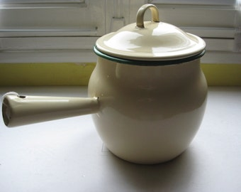 Vintage enamel pot with lid and handle.