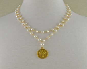 Double stradn necklace with Fleur de lis pendant