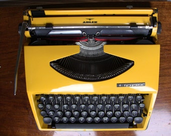 Yellow Tippa Adler Triumph Portable Typewriter QWERTY High Quality 1970 Made in the Netherlands Working Typewriter - NEW Black Ribbon