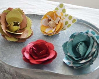Paper flower hair clips, can be made to order in any color.  3 for 7 dollars