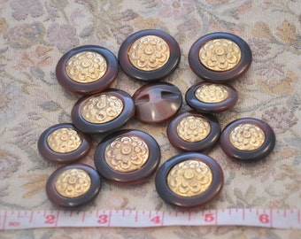 vintage metal button with central flower gold