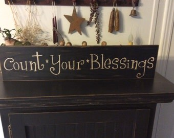 Primitive signs with sayings that are distressed , antiqued , sealed and ready to hang.