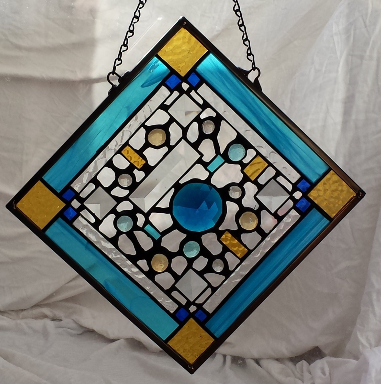 Teal decorative stained glass window hanging by for Decorative stained glass windows