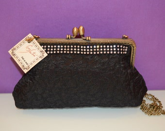bag with embellishment rhinestones and kiss clasp