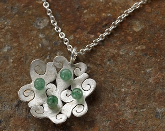 """Pendant """"pears of the sea"""" - elaborately and lovely worked in silver, with speres out of Aventurin gemstone"""
