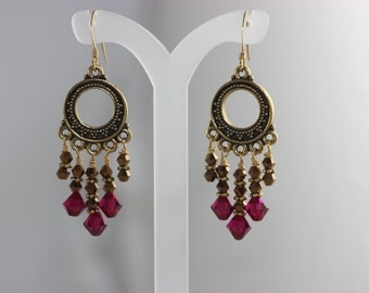 Chandelier drop earrings made with ruby red Swarovski crystals and bronze seed beads.
