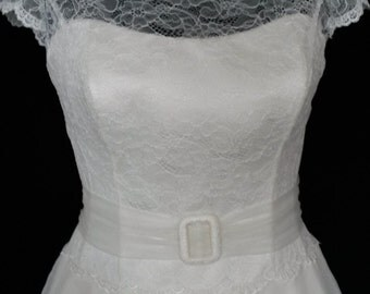1950's style tea length wedding dress. Lace bodice with full circle skirt, which has full petticoat and hoop attached.