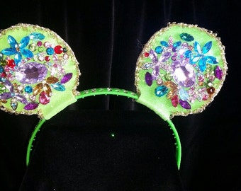 Multi-colored rhinestone covered mouse ears