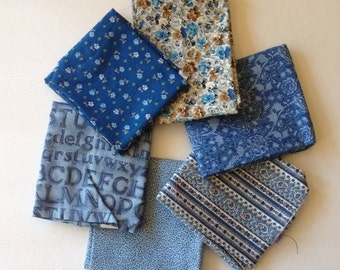 Blue and brown fabric bundle, some vintage, fat quarters, text, floral