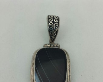 Beautiful Sterling Silver Pendant with Black Stone in the Center