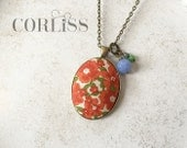Floral fabric pendant necklace - with pops of color accent beads - orange / green flower print, antique bronze / brass necklace