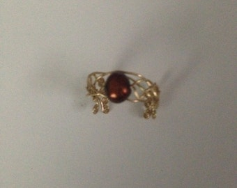 Red pearl and gold weave ring