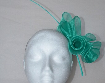 Emerald green flower fascinator. Hand made.