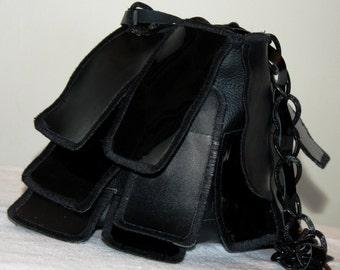 Black clutch bag leaves