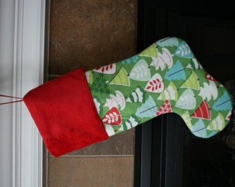 Colorful trees on Green Christmas Stocking can be personalized