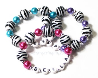 One Zebra Print bracelet bracelet. YOU CHOOSE the pearl color. Personalized name bracelet. Animal print personalized party favor bracelet.